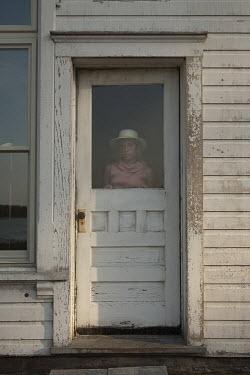 Terry Bidgood WOMAN STANDING IN DOOR OF OLD WHITE HOUSE Women