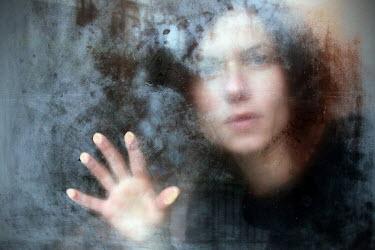 Romina Dughero WOMAN TOUCHING WINDOW WITH HAND Women