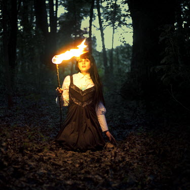 Amy Ballinger WOMAN WITH FIRE IN WOODS Women