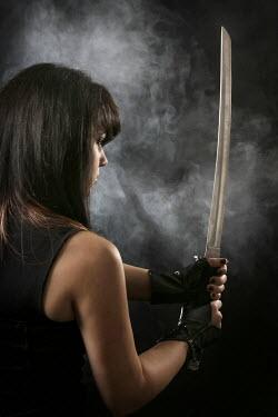 Stephen Carroll WOMAN HOLDING SAMURAI SWORD Women