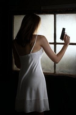 Stephen Carroll WOMAN HOLDING GUN BY WINDOW Women