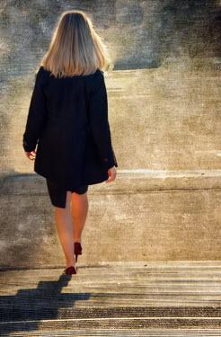 Elisabeth Ansley BLONDE BUSINESSWOMAN DESCENDING SUNLIT STEPS Women