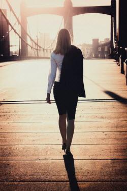 Elisabeth Ansley BUSINESS WOMAN WALKING ON BRIDGE Women
