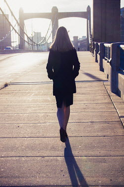 Elisabeth Ansley BUSINESSWOMAN WALKING ON EMPTY BRIDGE Women