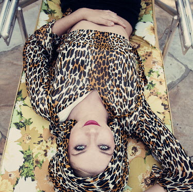 Heather Evans Smith GLAMOROUS WOMAN LYING ON SUNBED Women