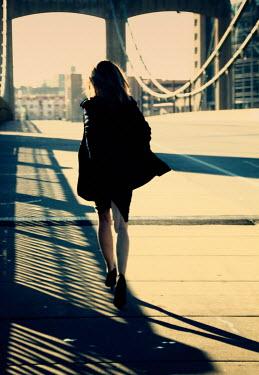 Elisabeth Ansley WOMAN WALKING ON MODERN BRIDGE Women