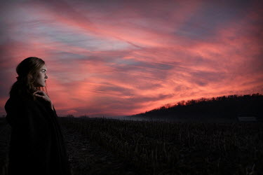 Stephen Carroll WOMAN IN LANDSCAPE WITH SUNSET Women
