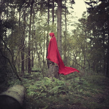 Sam Williamson WOMAN IN RED CAPE OUTDOORS Women