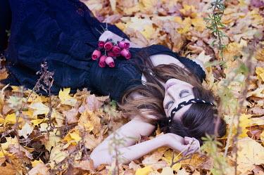 Sam Williamson WOMAN LYING ON LEAVES OUTDOORS Women