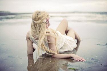 Sam Williamson BLONDE GIRL LYING ON BEACH Women