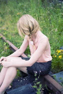 Sam Williamson GIRL SITTING ON DISUSED TRACKS Women