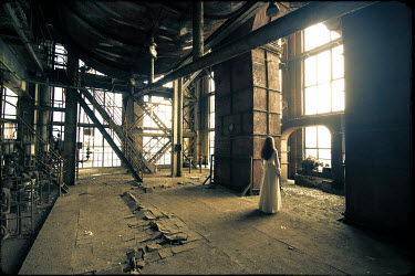 Christophe Dessaigne WOMAN ALONE IN ABANDONED WAREHOUSE Women