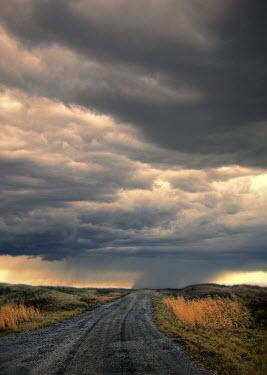 Jill Battaglia EMPTY STORMY RURAL ROAD Roads