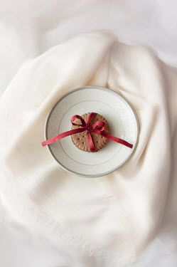 Agnieszka Kielak BISCUIT WITH RIBBON ON PLATE Miscellaneous Objects