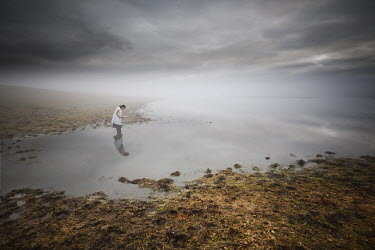 Leszek Paradowski WOMAN STANDING IN MISTY LAKE Women
