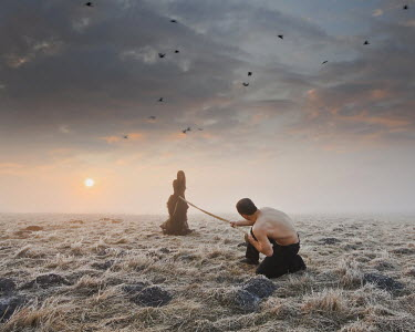 Leszek Paradowski COUPLE PULLING ROPE IN FIELD Couples