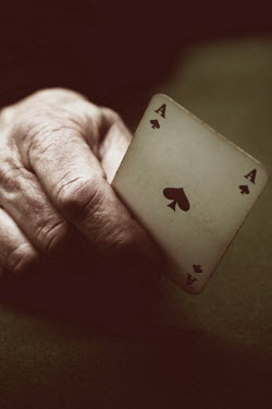 Ilona Wellmann ELDERLY HAND HOLDING PLAYING CARD Body Detail