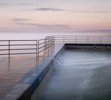 Tony Worobiec MISTY SEA WITH EMPTY LIDO Seascapes/Beaches