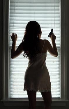 Stephen Carroll WOMAN WITH GUN BY WINDOW Women