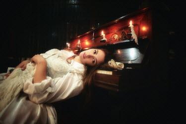 Kamil Akca DEAD WOMAN LYING ON PIANO Women