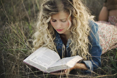 Heather Rous BLONDE WOMAN READING OUTDOORS Women
