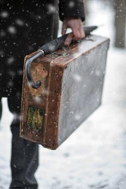 Lee Avison MAN WITH SUITCASE IN SNOW Men