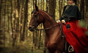 Vitali Kurets HISTORICAL WOMAN RIDING IN WOODS Women