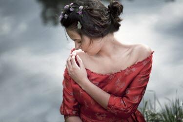 Nikaa MEDIEVAL WOMAN WITH FLOWERS BESIDE LAKE Women