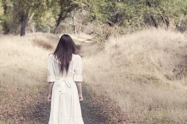 Sam Williamson female standing on country path Women
