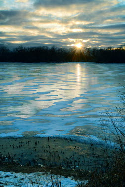 Jill Battaglia EMPTY FROZEN LAKE WITH SUNSET Lakes/Rivers