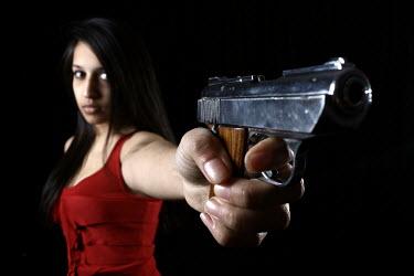 Stephen Carroll ASIAN WOMAN STANDING POINTING GUN Women