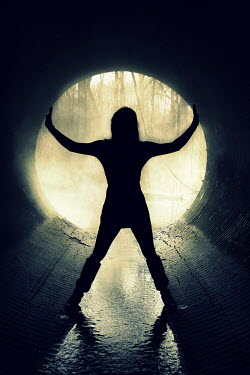Stephen Carroll SILHOUETTED WOMAN STANDING IN TUNNEL Women