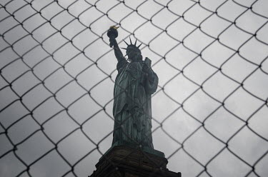 Mohamad Itani STATUE OF LIBERTY WITH FENCE Specific Cities/Towns