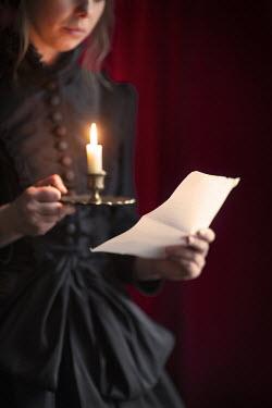Lee Avison VICTORIAN WOMAN READING BY CANDLELIGHT Women