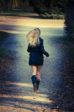 Jitka Saniova BLONDE GIRL RUNNING IN PARK Women