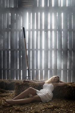 Stephen Carroll WOMAN LYING IN SUNLIT BARN Women