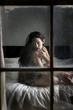 Stephen Carroll ANXIOUS WOMAN ON BED INDOORS Women