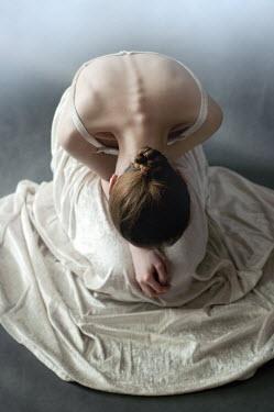 Agnieszka Kielak WOMAN IN WHITE DRESS BOWING Women