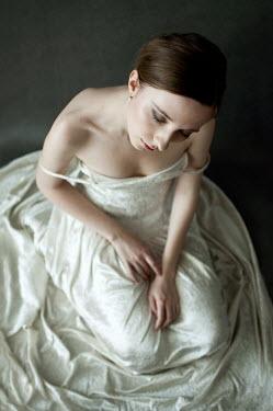 Agnieszka Kielak WOMAN IN WHITE SITTING DREAMING Women