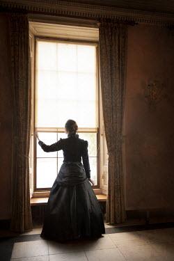 Lee Avison VICTORIAN WOMAN STANDING BY WINDOW Women