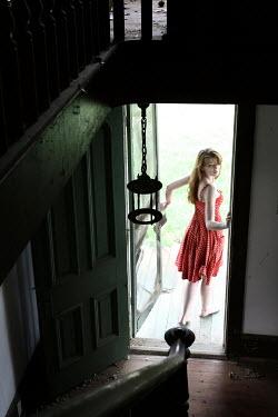 Stephen Carroll WOMAN LOOKING BACK INTO HOUSE Women