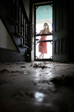 Stephen Carroll WOMAN LOOKING IN ABANDONED HOUSE Women