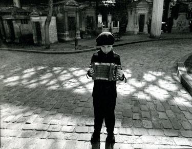 Andrew Davis BOY WITH ACCORDION IN CEMETERY Children