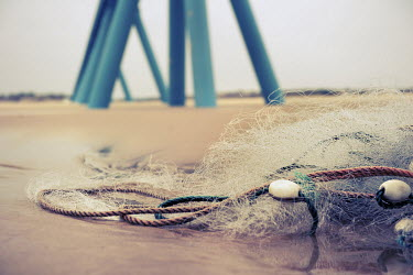 Christine Amat STILTS ON BEACH WITH NETS Seascapes/Beaches