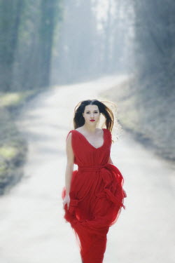 J.A Rausch WOMAN IN RED ON ROAD Women