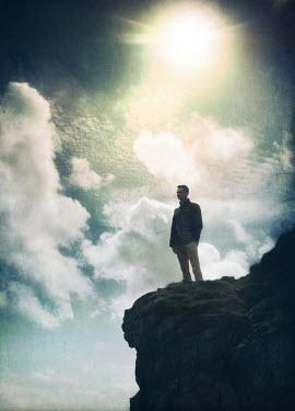 Mark Owen MAN ON CLIFF WITH SUNLIGHT Men