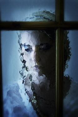 Nic Skerten SERIOUS WOMAN WAITING BEHIND GLASS Women