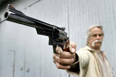 Stephen Carroll MAN WITH MUSTACHE POINTING GUN Old People