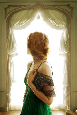 ILINA SIMEONOVA WOMAN IN GREEN BY WINDOW Women
