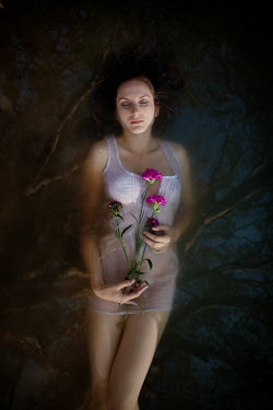 Pini Hamou WOMAN FLOATING WITH PINK FLOWERS Women